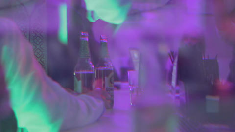 Blurred silhouettes of people at bar, pov of drunk person Footage