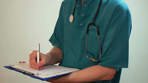 Doctor writing a report, Rx prescription, discharging a patient Footage