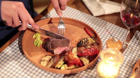 Restaurant visitors enjoying huge grilled steak with vegetables Footage