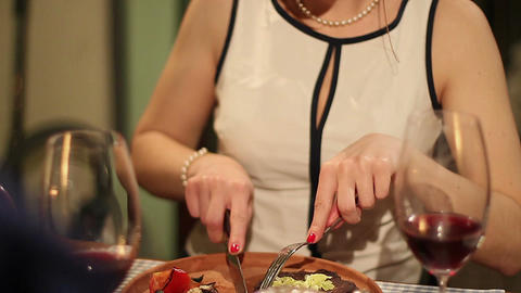 Pretty woman enjoying the taste of grilled steak in restaurant Footage