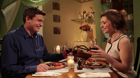 Couple having romantic dinner with candlelight, man saying toast Footage