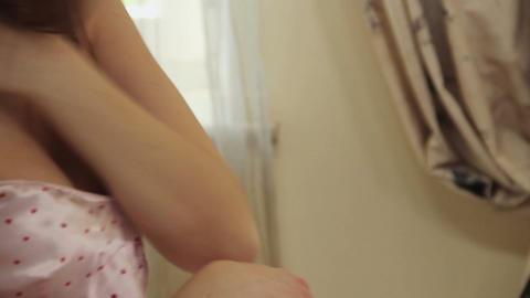 Seductive female in lingerie kisses and undresses boyfriend, Live Action