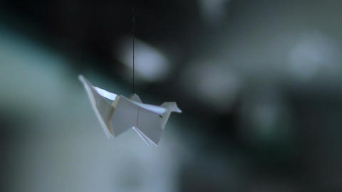 Origami bird spinning around, handmade, Japanese art of paper Footage