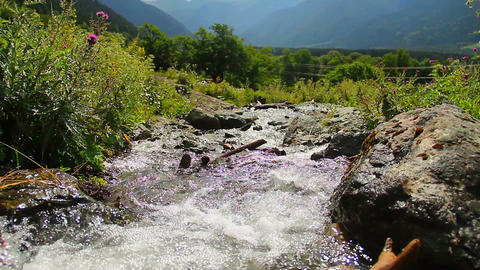 Mountain torrent running rapidly between the rocks, nature Footage