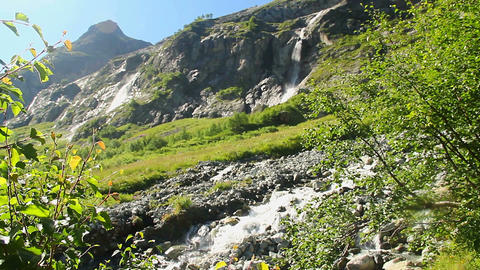 Mountain stream flowing down the slope, beautiful nature Footage