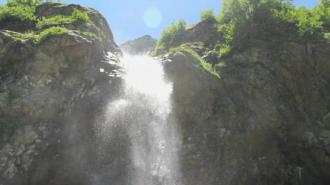 Mountain waterfall, water gushing over the rocks, low angle Footage