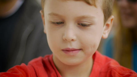 Close up of a young boy concentrating on something using his imagination or play Footage