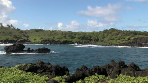 Maui Hana Black lava beach Hawaii pan right HD Footage