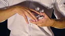 Closeup Conjurer Hands Shuffle Cards against White Shirt Footage
