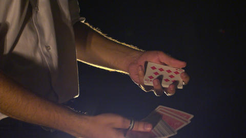 Closeup Side View Hands Shuffle Cards against Darkness Footage