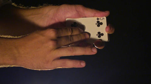 Closeup Hands Show Black Clubs Card against Darkness Footage