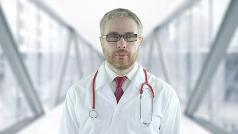 Confident doctor in the modern hospital glass hallway. Shot on Red camera Live Action