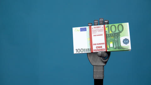 A mechanical hand holds a bundle of euros. A gray cyborg hand holds money on a Live Action
