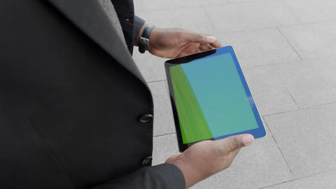 Businessman scrolling tablet on street. Entrepreneur working on pad outdoors Live Action