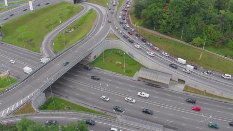 City traffic during rush hour, busy road junction. Aerial view Footage