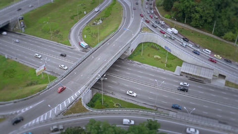 Aerial shot of busy road junction, fast and slow-driving cars Footage