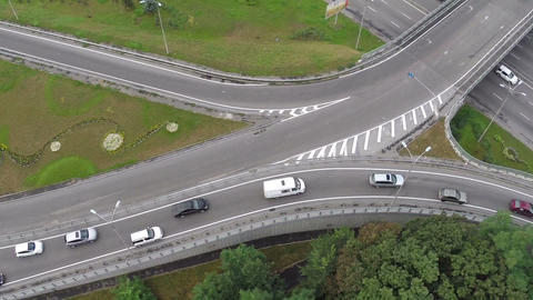 Aerial vertical view of car traffic driving busy city freeway Footage