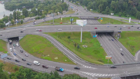 Bridge over busy highway junction, heavy traffic, aerial shot Footage