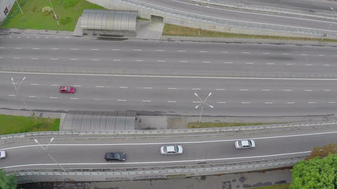Fast-driving car traffic on city highway, view from above Footage