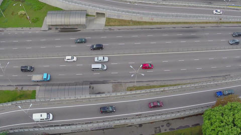 Aerial car traffic driving the busy city freeway, vertical shot Footage