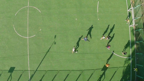 Amateur football, aerial shot of players running on the field Footage