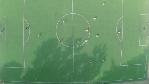 Aerial vertical view of professional football team on the field Footage