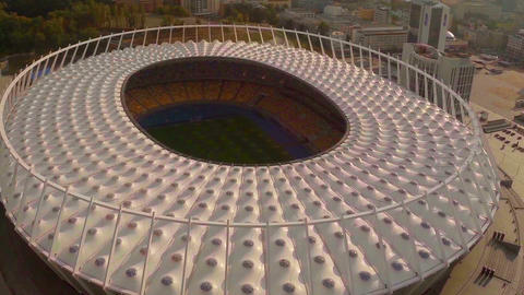 Aerial shot of large football (soccer) stadium, flying above Footage
