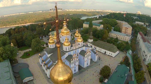 Flying above beautiful city, cathedral and buildings, aerial Footage