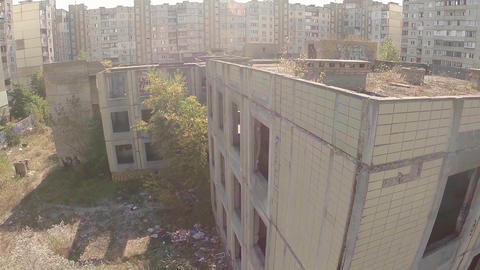 Aerial view wrecked abandoned building, no people, deserted city Footage