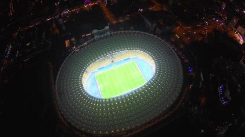 Amazing panorama of football stadium, illumination, aerial view Footage