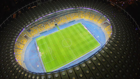 Football match on large stadium field, vertical aerial view, 4k Footage