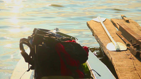 Tourist backpack in canoe at sunset. Tourism, traveling, holiday Footage
