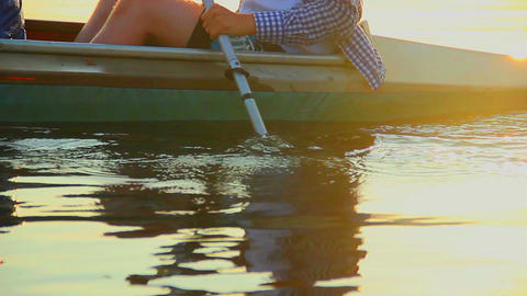 Close-up of man paddling boat. Water ripples and splashes Footage