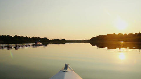 Beautiful waterscape, tourists paddling kayak at sunset Footage