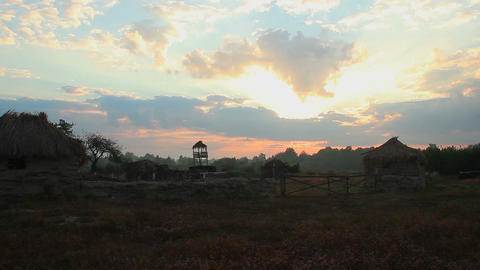 Time-lapse, sky above old farm in countryside. Beautiful sunrise Footage