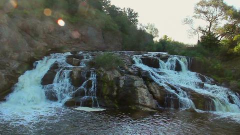 Beautiful view of mountain waterfall, water running down rocks Footage