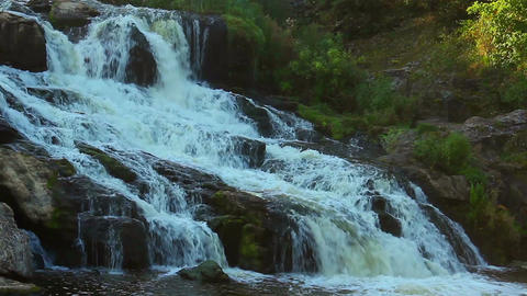 Magnificent cascade waterfall in the woods. Beautiful landscape Footage