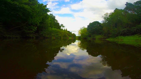 Wide river landscape, calm water surface. Boating, tourism Footage