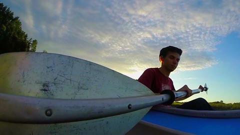 Two guys kayaking at sunset, sport, action camera, traveling Footage