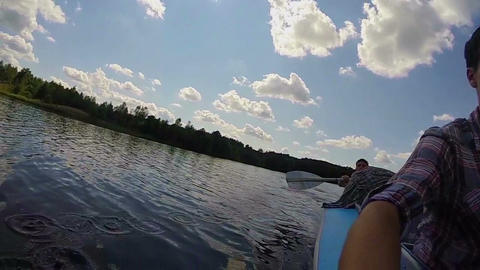 Two young males paddling canoe, action camera, gopro, slowmotion Footage