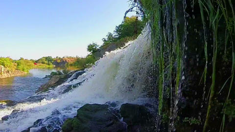 Turbulent waterfall splashing against rocks, river, wild nature Footage