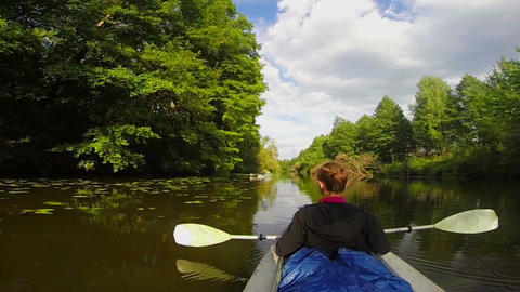 Girl traveler sitting in kayak, resting. Wide river, slow motion Footage