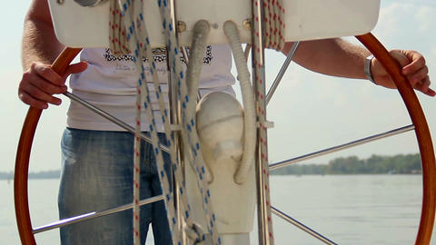Closeup male captain steering boat on river, sailing, yachting Footage