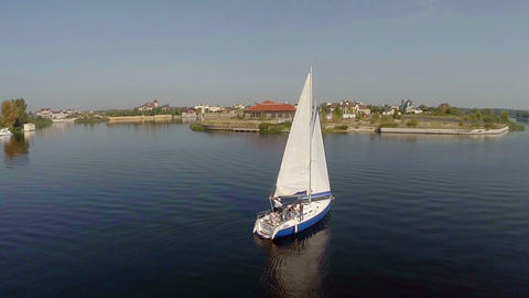 Aerial view, beautiful yacht cruising on river, crew on deck Footage