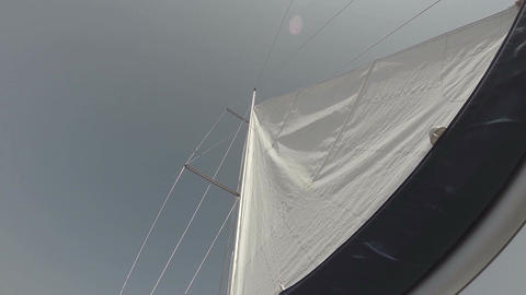 White sail in wind against sky, low angle shot, yachting Footage