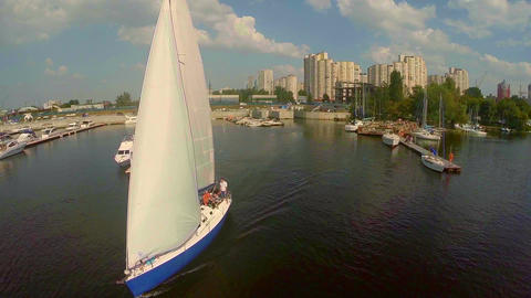 Aerial of sailboat leaving dock. Summer vacation, active rest Live Action