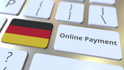 Online Payment text and flag of Gemany on the keyboard. Modern finance related Live Action