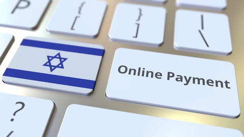 Online Payment text and flag of Israel on the keyboard. Modern finance related Live Action