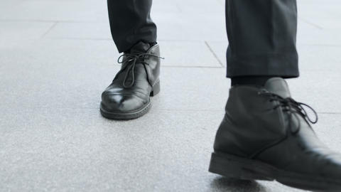 Businessman in black shoes going for job. Man legs walking on city road Live Action