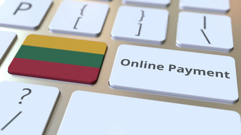Online Payment text and flag of Lithuania on the keyboard. Modern finance Live Action